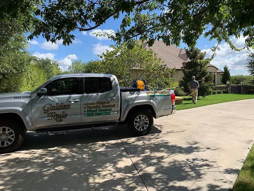Company truck of Golden Rule Pest Termite Weed Control